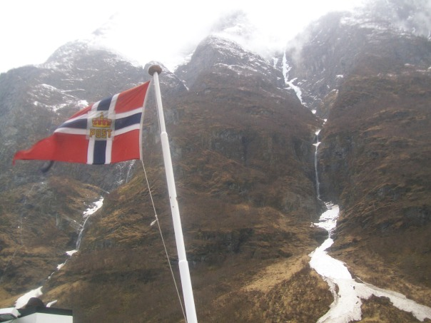 Norway postal service flag and Naeroyfjord ice waterfall.